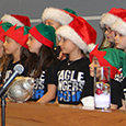 Students line up to sing at Holiday Open House.