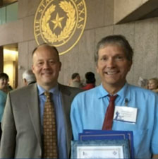 picture of Dr. Chadwell with Tom Bainter and his award in Austin