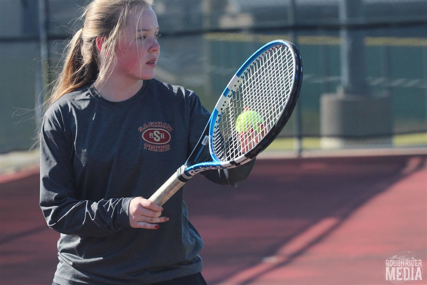 photo of SHS tennis player courtesy of Rough Rider Media