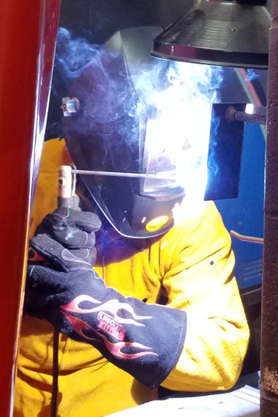 HCTC student welds metal