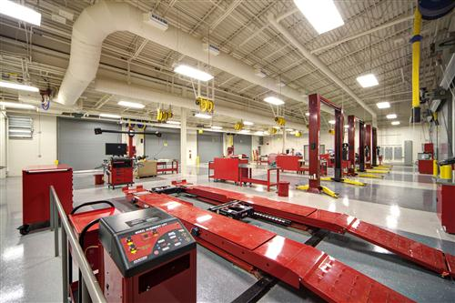 Shop photo with automotive bays and lifts
