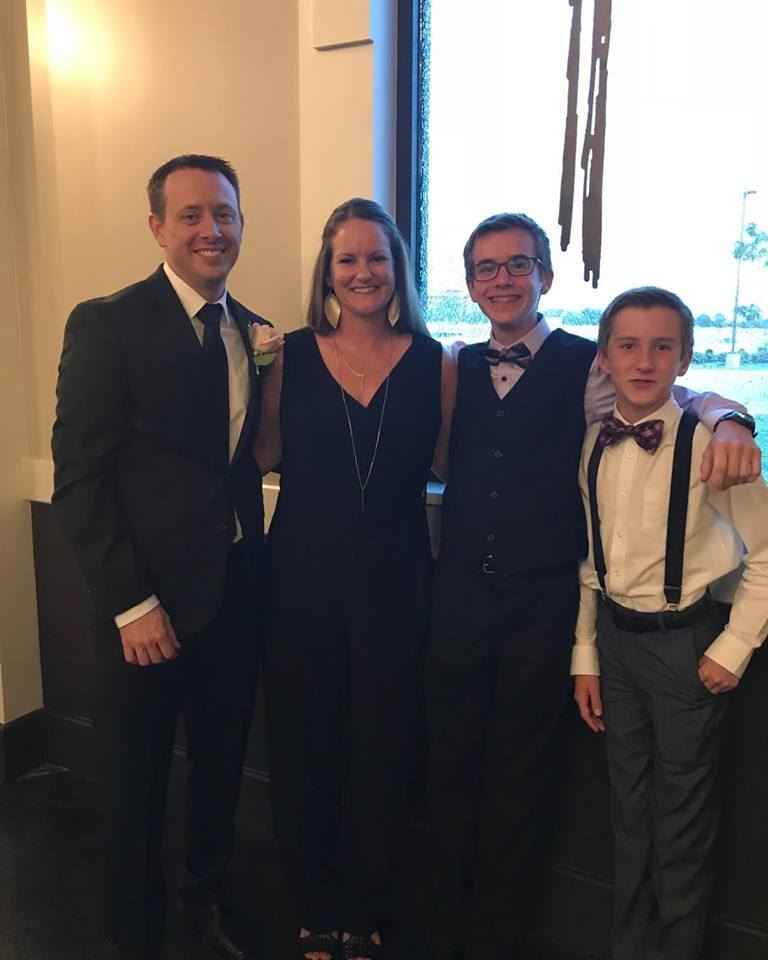 photo of T Shelton with husband and two sons