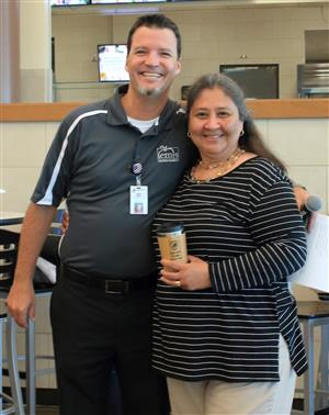 Aaron Wylie, director of child nutrition, with Brenda Moreno