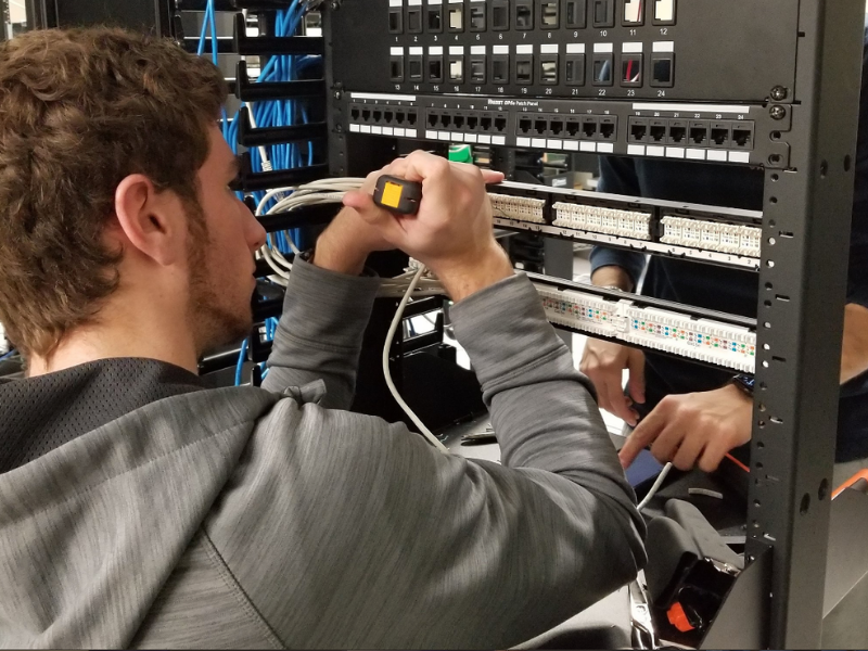 Student working on computer hardware