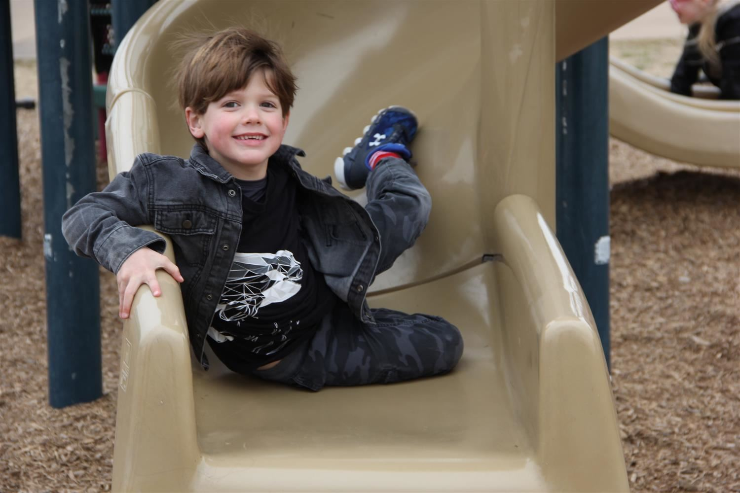 male GFES student enjoys some time on the slide