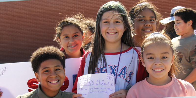 Group of Elementary Students outside smiling