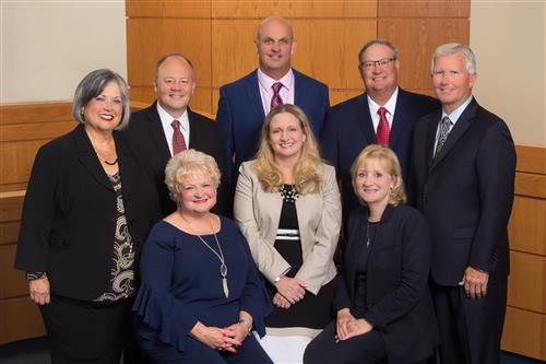photo of the board of education with superintendent